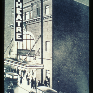 A photograph showing the outside of the Walk Theatre, with people and cars passing by. Source: City of Winnipeg Archives.