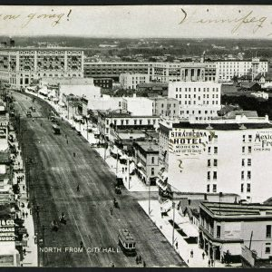 Main street showing Strathcona Hotel on right. COWA Martin Berman Postcard Collection.