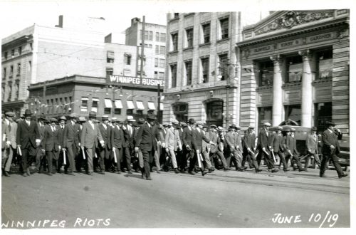 Special Police marching west down Portage from Main Street, June 10 Riot.  Winnipeg Tribune Photograph Collection. UMASC.