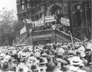 Anti-strike veterans parading at City Hall holding signs against Bolshevism and