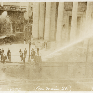 Bloody Saturday: Special Policemen fire hoses to disperse the crowd at Portage and Main. Winnipeg Tribune fonds. UMASC.