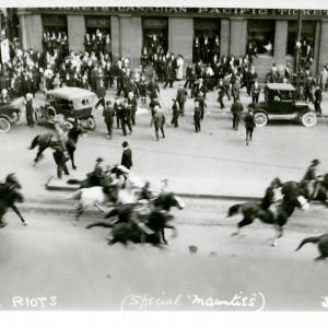 Special Policemen riding east on Portage Avenue, towards Main Street. Winnipeg Tribune fonds, June 10, 1919. UMASC.